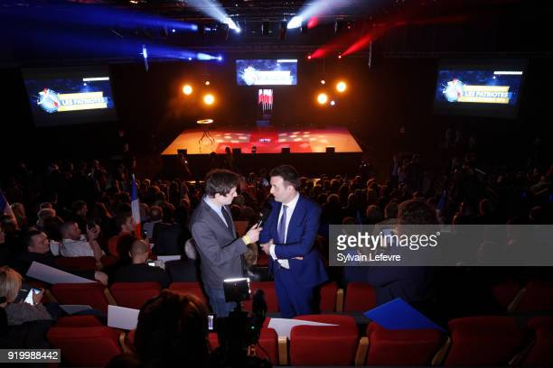 Florian Philippot leader of farright movement 'Les Patriotes' speaks to a journalist during their first congress on February 18 2018 in Arras France...