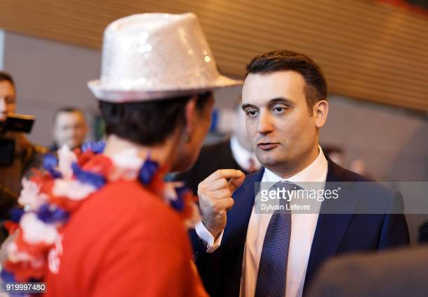 Florian Philippot leader of farright movement 'Les Patriotes' speaks to an attendee during their first congress on February 18 2018 in Arras France...