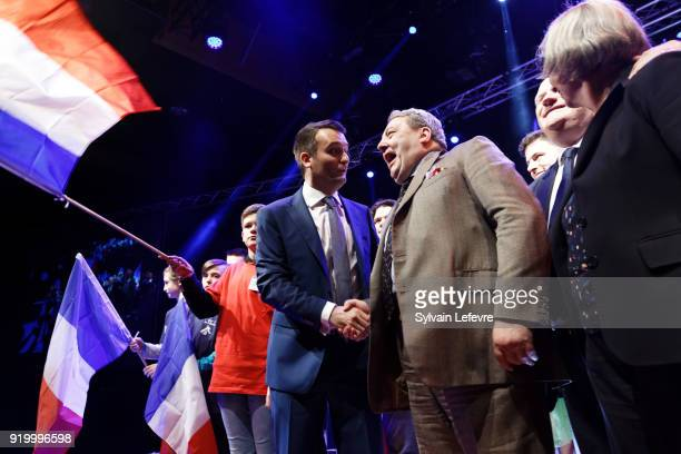 Florian Philippot leader of farright movement 'Les Patriotes' stands next to Scottish UKIP leader David Coburn as they stand on stage during the...