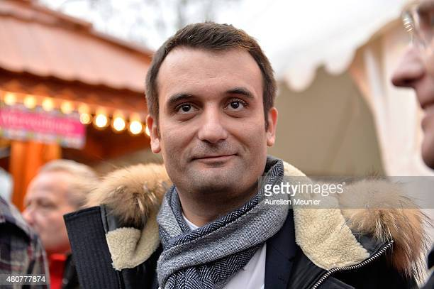Florian Philippot National Front vice president visits the Christmas Market on the Champs Elysees on December 22 in Paris France