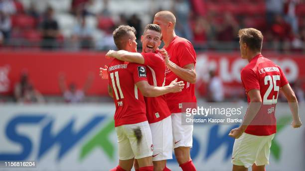Florian Pick of 1FC Kaiserslautern celebrates after scoring his team`s first goal with team mates Christian Kuehlwetter of 1FC Kaiserslautern and...