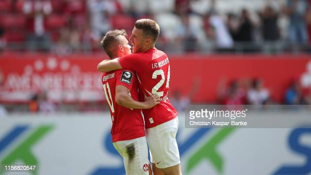 Florian Pick of 1FC Kaiserslautern celebrates after scoring his team`s first goal with teammate Christian Kuehlwetter of 1FC Kaiserslautern during...