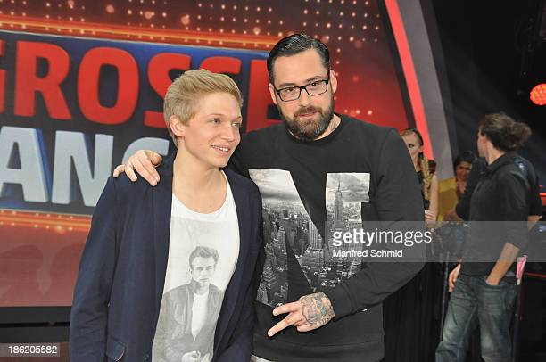 Florian Ragendorfer and Sido pose on stage during the aftershow party of TV Show 'Die Grosse Chance' at ORF center on October 25 2013 in Vienna...