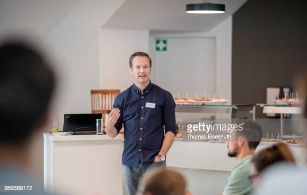 Florian Schultz of the university of Tuebingen speaks during the DFB academy think tank summit at Red Bull Arena Leipzig on May 9 2018 in Leipzig...