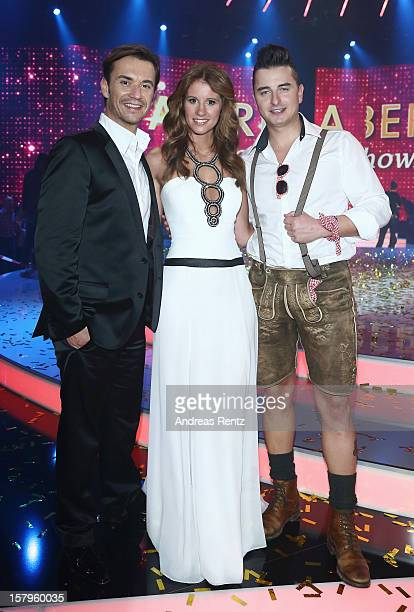 Florian Silbereisen Mareile Hoeppner and Andreas Gabalier attend the Andrea Berg 'Die 20 Jahre Show' at Baden Arena on December 7 2012 in Offenburg...
