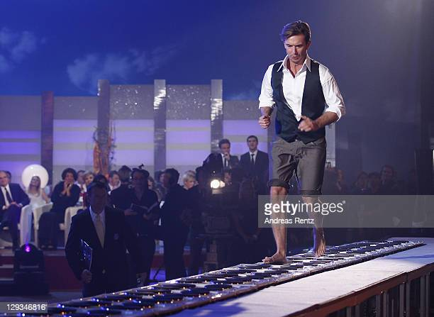 Florian Silbereisen runs barefoot over heated boiling plates during the 'Das Herbstfest der Abenteuer' music show on October 15 2011 in Chemnitz...
