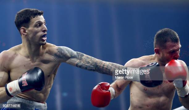 Florian Sparakowski of Germany exchange punches with Giorgi Gujejiani of Georgia during their middleweight fight at Arena Nurnberger on February 24...