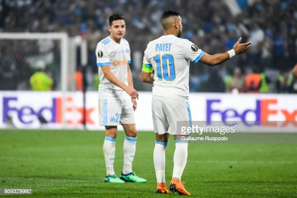 Florian Thauvin and Dimitri Payet of Marseille look dejected during the Europa League Final match between Marseille and Atletico Madrid at Groupama...