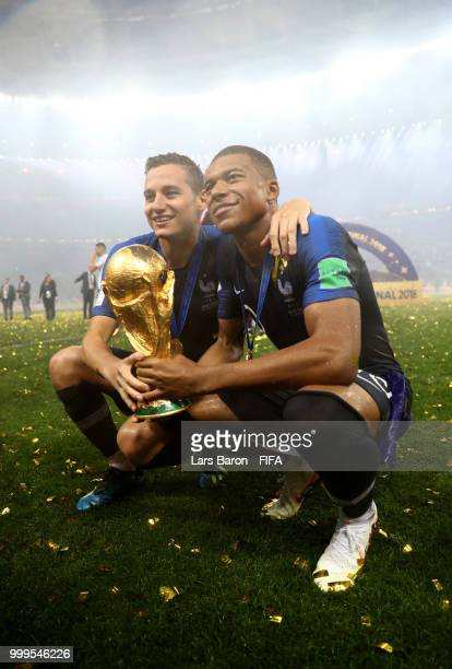 Florian Thauvin and Kylian Mbappe of France celebrate victory with the World Cup trophy following the 2018 FIFA World Cup Final between France and...