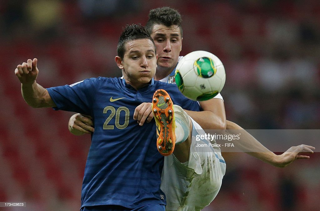 Florian Thauvin (L) of France and Jose Gimenez of Uruguay compete for the ball during the FIFA U-20 World Cup Final match between France and Uruguay at Ali Sami Yen Arena on July 13, 2013 in Istanbul, Turkey.