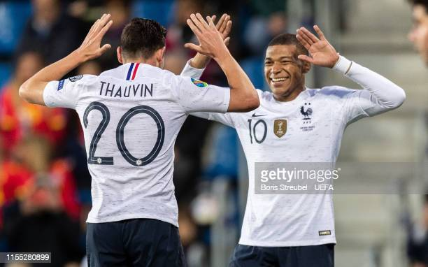Florian Thauvin of France celebrates with team mate Kylian Mbappe of France after scoring his team's third goal during the UEFA Euro 2020 Qualifier...