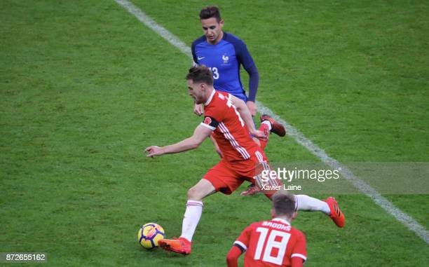 Florian Thauvin of France in action with Aaron Ramsey of Wales after the friendly match between France and Wales at Stade de France on November 10...