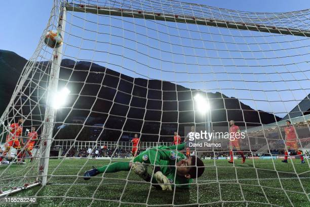 Florian Thauvin of France scores his team's third goal past Josep Gomes of Andorra during the UEFA Euro 2020 Qualification match between Andorra and...