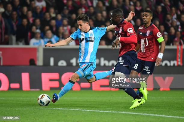 Florian Thauvin of Marseille and Adama Soumaoro of Lille during the Ligue 1 match between Lille OSC and Olympique de Marseille at Stade Pierre Mauroy...