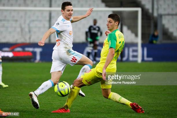 Florian Thauvin of Marseille and Andrei Girotto of Nantes during the Ligue 1 match between Olympique Marseille and Nantes at Stade Velodrome on March...