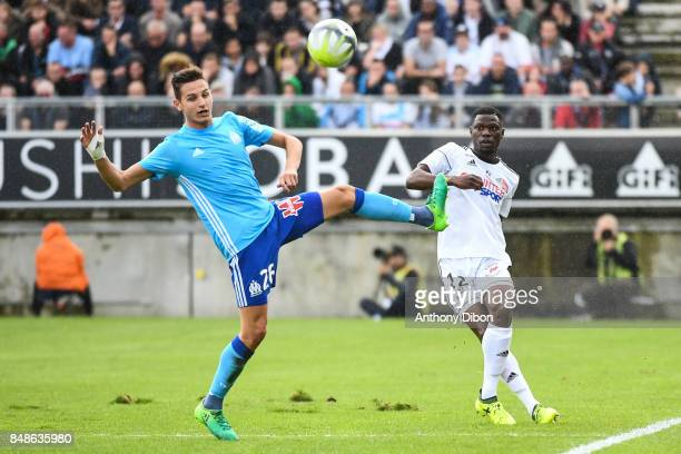 Florian Thauvin of Marseille and Bakaye Dibassy of Amiens during the Ligue 1 match between Amiens SC and Olympique Marseille at Stade de la Licorne...