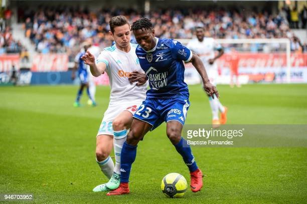 Florian Thauvin of Marseille and Charles Blonda Traore of Troyes during the Ligue 1 match between Troyes Estac and Olympique de Marseille at Stade de...