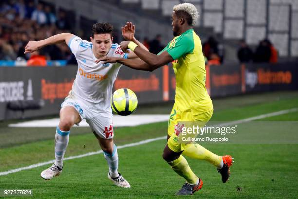 Florian Thauvin of Marseille and Chidozie Awaziem of Nantes during the Ligue 1 match between Olympique Marseille and Nantes at Stade Velodrome on...