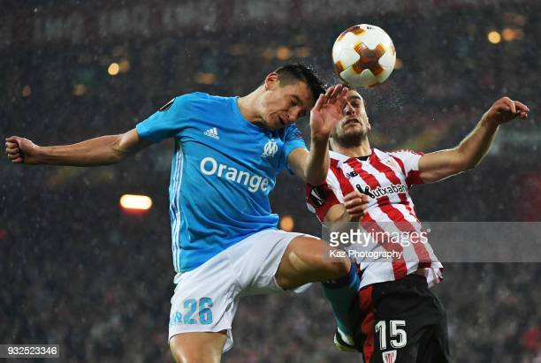 Florian Thauvin of Marseille and Inigo Lekue of Athletic Bilbao compete for the ball during UEFA Europa League Round of 16 match between Athletic...