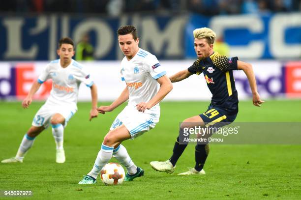 Florian Thauvin of Marseille and Kevin Kampl of Leipzig during the UEFA Europa League quarter final second leg match between Olympique Marseille and...