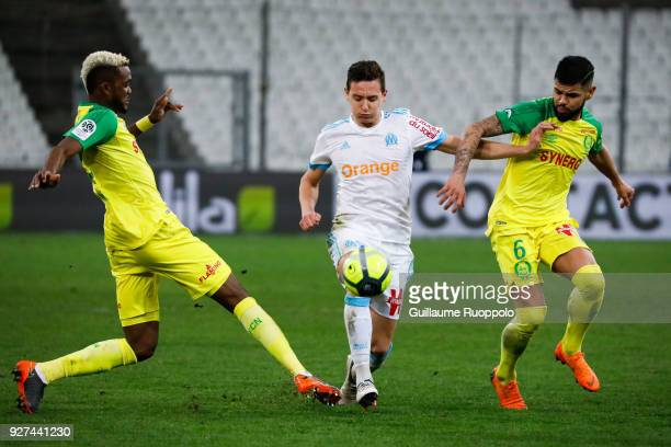 Florian Thauvin of Marseille and Lucas Lima of Nantes during the Ligue 1 match between Olympique Marseille and Nantes at Stade Velodrome on March 4...