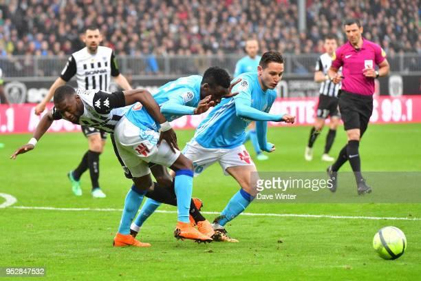 Florian Thauvin of Marseille Bouna Sarr of Marseille and Karl Toko Ekambi of Angers during the Ligue 1 match between Angers SCO and Olympique...