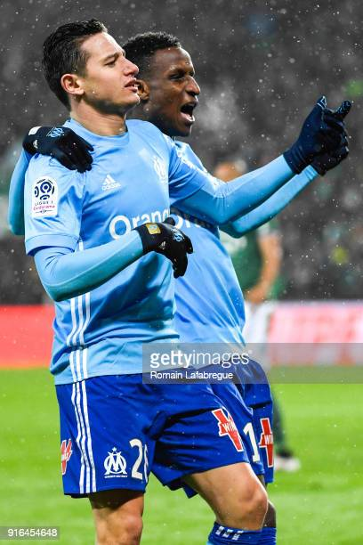 Florian Thauvin of Marseille celebrates after scoring a goal with Bouna Sarr of Marseille during the Ligue 1 match between AS SaintEtienne and...
