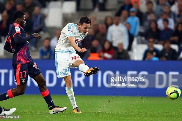 Florian Thauvin of Marseille kicks the ball under pressure from Andre Poko of Bordeaux during the French League 1 match between Olympique de...