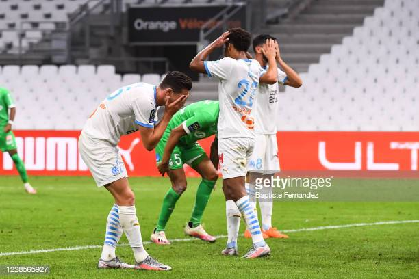 Florian THAUVIN of Marseille, Marley AKE of Marseille and Morgan SANSON of Marseille react dejected during the French Ligue 1 soccer match between...