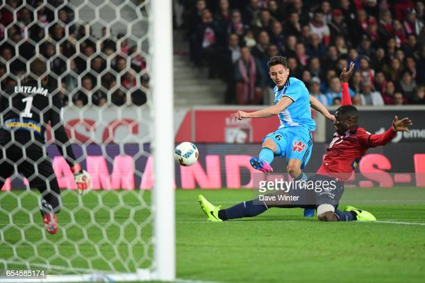 Florian Thauvin of Marseille sees his shot blocked by Adama Soumaoro of Lille during the Ligue 1 match between Lille OSC and Olympique de Marseille...