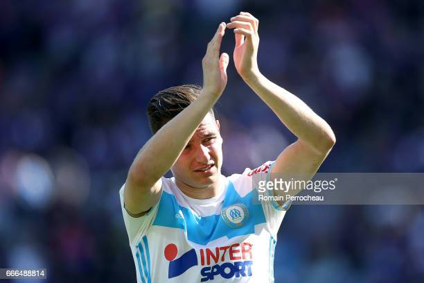 Florian Thauvin of Marseille waves fans after the French Ligue 1 match between Toulouse FC and Olympique de Marseille at Stadium Municipal on April 8...