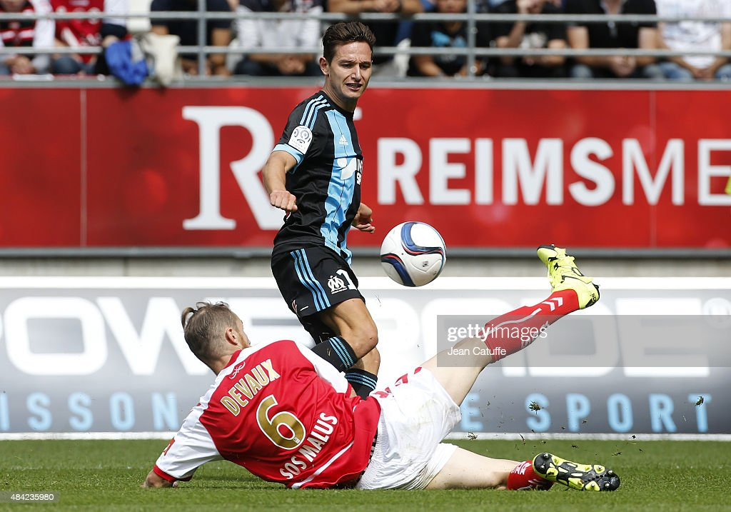 Florian Thauvin of Olympique de Marseille and Antoine Devaux of Stade de Reims in action during the French Ligue 1 match between Stade de Reims and Olympique de Marseille (OM) at Stade Auguste Delaune on August 16, 2015 in Reims, France.