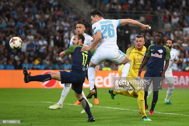 Florian Thauvin of Olympique de Marseille scores his team's first goal during the UEFA Europa League Semi Final First leg match between Olympique de...