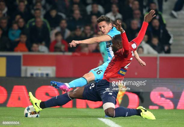 Florian Thauvin of OM and Adama Soumaoro of Lille in action during the Ligue 1 match between Lille OSC and Olympique de Marseille at Stade...