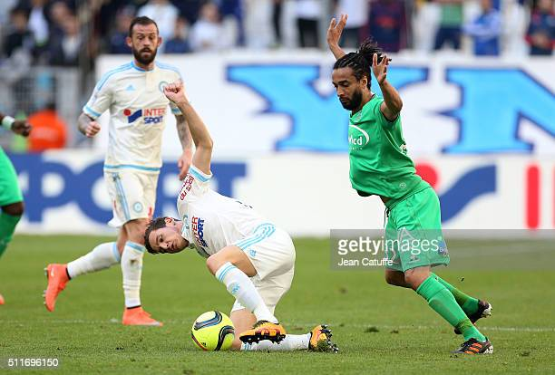 Florian Thauvin of OM and Benoit AssouEkotto of SaintEtienne in action during the French Ligue 1 match between Olympique de Marseille and AS...