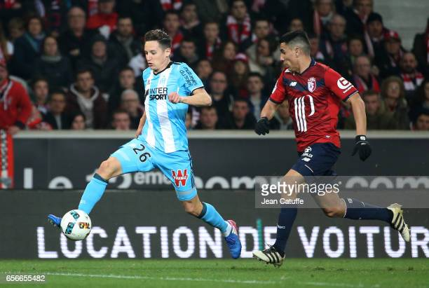 Florian Thauvin of OM and Junior Alonso of Lille in action during the Ligue 1 match between Lille OSC and Olympique de Marseille at Stade...