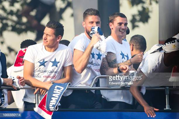Florian Thauvin Olivier Giroud Antoine Griezmann professional football players attend the France's World Cup Winning Team Parade Down The Champs...