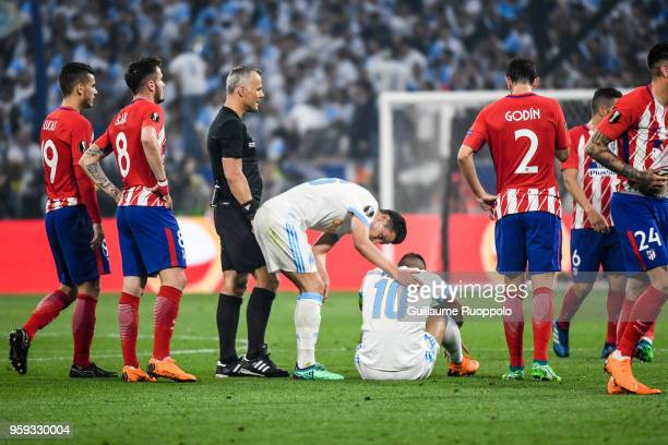 Florian Thauvin talks with Dimitri Payet of Marseille who looks injured during the Europa League Final match between Marseille and Atletico Madrid at...