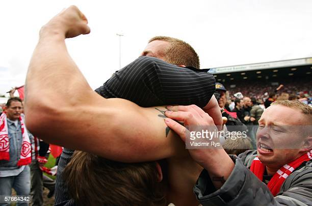 Florian Thorwart of Essen celebrates with the fans after the final whistle of the Third League match between Rot Weiss Essen and Werder Bremen II at...