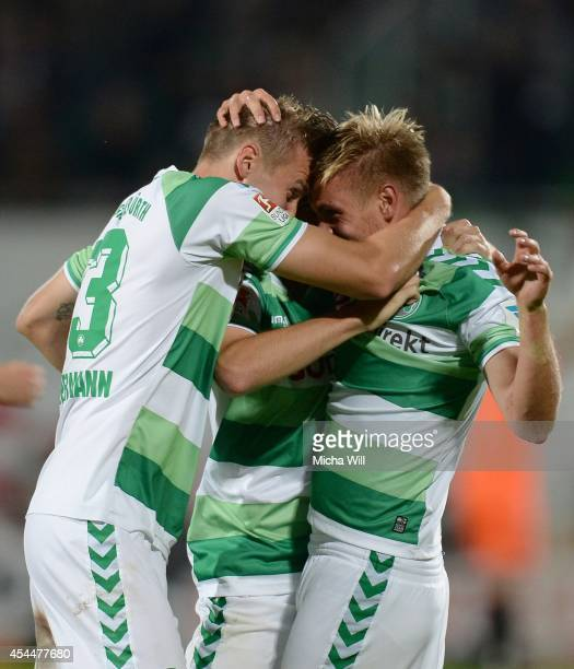 Florian Trinks of Fuerth celebrates with team-mates after scoring his team's third goal during the Second Bundesliga match between Greuther Fuerth...