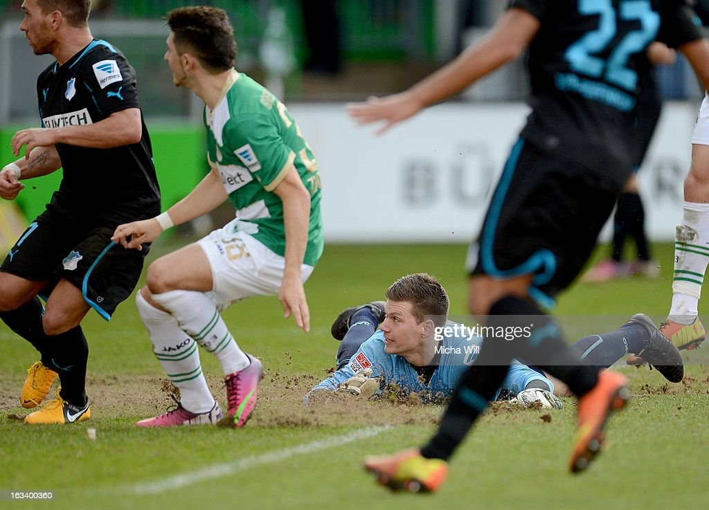 Florian Trinks of Fuerth (2nd R) lays on the ground after passing the ball by accident during the Bundesliga match between SpVgg Greuther Fuerth and TSG 1899 Hoffenheim at Trolli-Arena on March 9, 2013 in Fuerth, Germany.