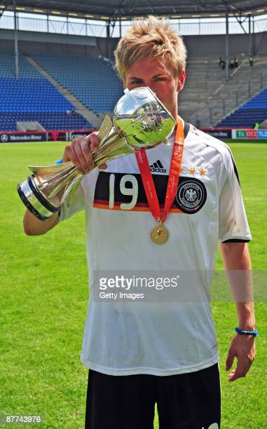 Florian Trinks of Germany celebrates with the trophy after winning the Uefa U17 European Championship Final between Netherlands and Germany at the...