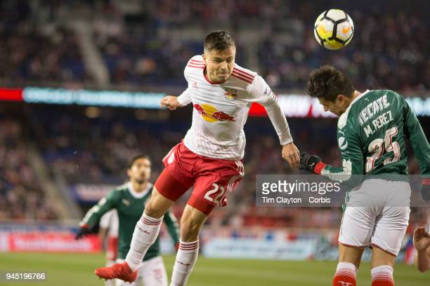 Florian Valot of New York Red Bulls heads towards goal while challenged by Michael Perez of C.D. Guadalajara during the New York Red Bulls Vs C.D....