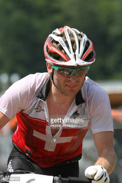 Florian Vogel of Switzerland rides before crossing the finish line to win the silver medal at the final of the cross country elite men at the UCI...
