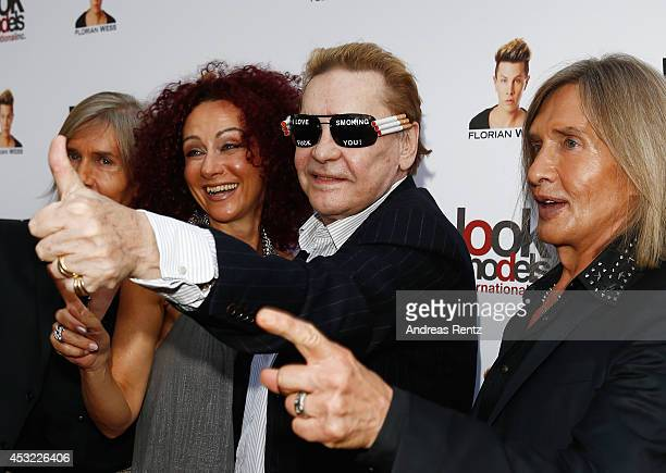 Florian Wess Christina aka Mausi Lugner Helmut Berger and Oskar Wess attend the GarconF fashion show at BalloniHallen on August 5 2014 in Cologne...