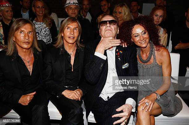 Florian Wess Oskar Wess Helmut Berger and Christina aka Mausi Lugner attend the GarconF fashion show at BalloniHallen on August 5 2014 in Cologne...
