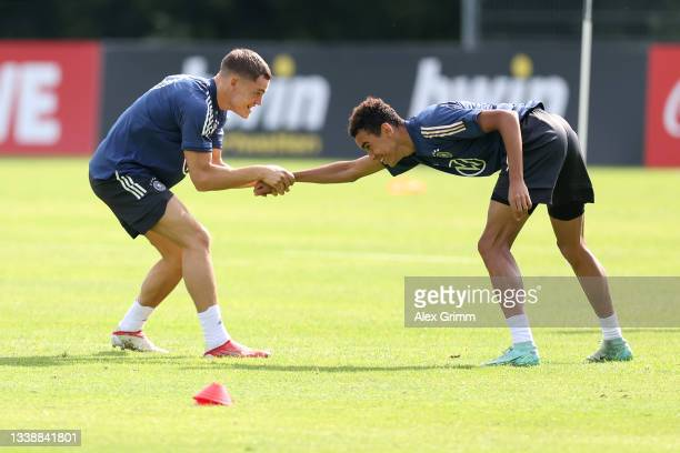Florian Wirtz and Jamal Musiala exercise during a Germany training session at ADM-Sportpark on September 07, 2021 in Stuttgart, Germany.