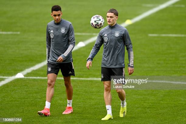 Florian Wirtz and Jamal Musiala warm up during a training session at Esprit-Arena on March 23, 2021 in Duesseldorf, Germany.