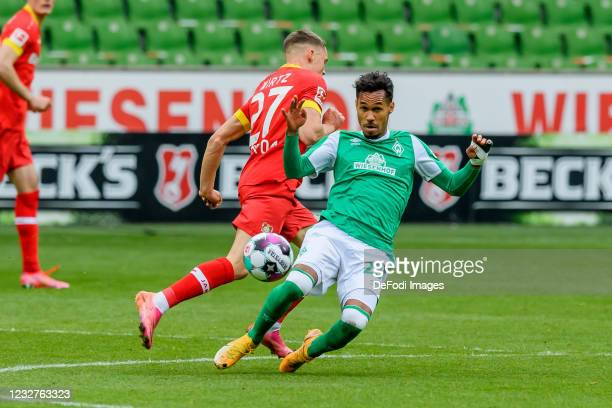 Florian Wirtz of Bayer 04 Leverkusen and Theodor Gebre Selassie of SV Werder Bremen battle for the ball during the Bundesliga match between SV Werder...