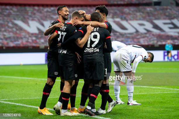 Florian Wirtz of Bayer 04 Leverkusen celebrates with his team-mates Karim Bellarabi, Moussa Diaby and Nadiem Amir after scoring their sixth goal...